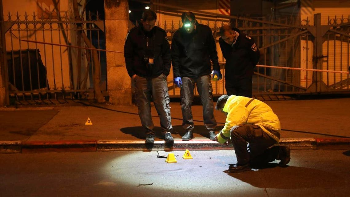 Israeli police officers inspect the scene of an attack in Jerusalem, early Thursday, Feb. 6, 2020. (Photo: AP)