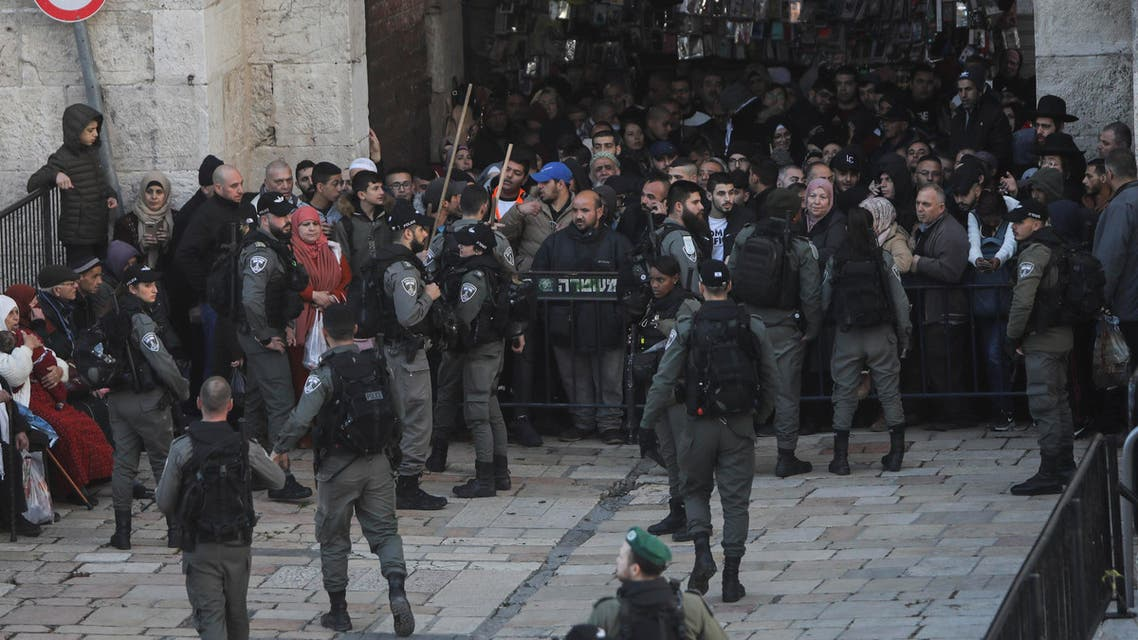 Israeli border police blocks exit of the Old City's Damascus gate ahead of a protest against Middle East peace plan announced Tuesday by US President Donald Trump, which strongly favors Israel, in Jerusalem, Wednesday, Jan 29, 2020. (AP Photo/Mahmoud Illean)