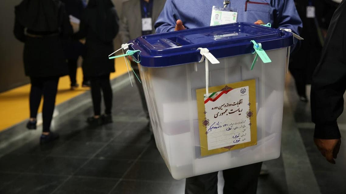 An electoral worker carries a ballot box after closing vote in a polling station in Tehran, Iran, May 19, 2017. (Reuters)