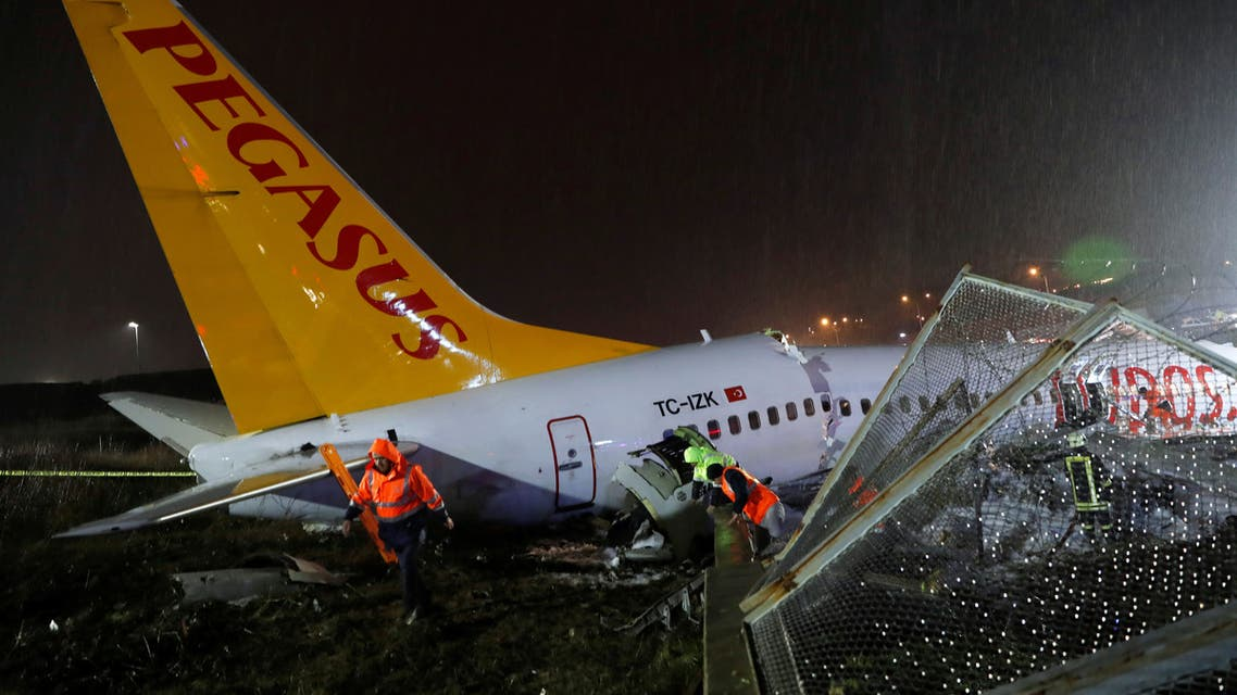 First responders work near the Pegasus Airlines Boeing 737-86J plane's broken-up fuselage, after it overran the runway during landing and crashed, at Istanbul's Sabiha Gokcen airport, Turkey February 5, 2020. REUTERS/Murad Sezer