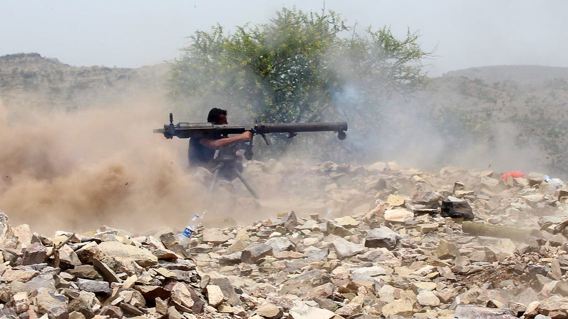 A Yemeni pro-government fighter fires a recoilless rocket launcher weapon as Saudi and Emirati supported forces take over Huthi bases on the frontline of Kirsh between the province of Taez and Lahj, southwestern Yemen, on July 1, 2018. The United Arab Emirates on Sunday announced it had halted the offensive it is backing against Huthi rebels in Yemen's port city of Hodeida to give a chance to UN diplomatic efforts.
