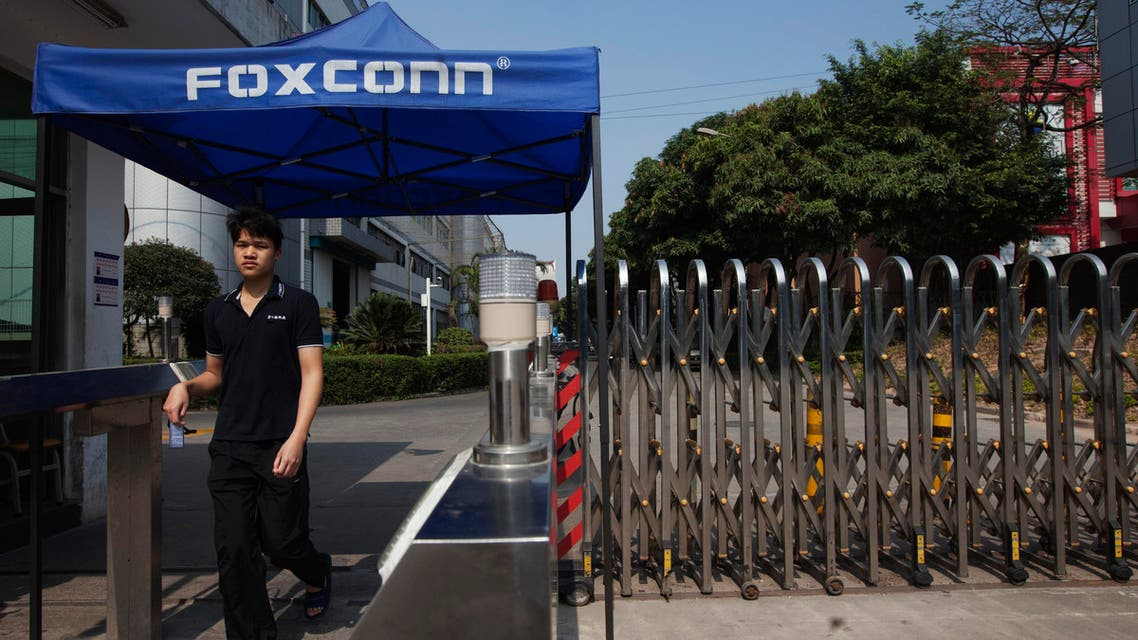 A worker leaves a Foxconn factory in the township of Longhua in Shenzhen, Guangdong province February 21, 2013. (Reuters)
