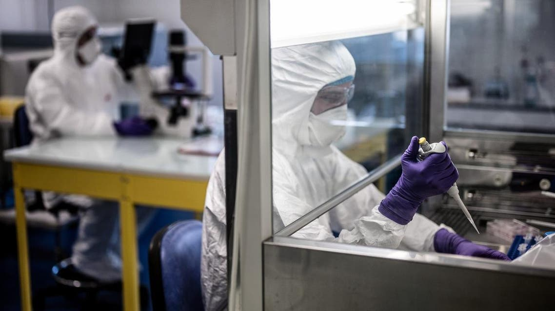 Scientists are at work in the VirPath university laboratory in Lyon, France, February 5, 2020 as they try to find an effective treatment against the new SARS-like coronavirus. (AFP)