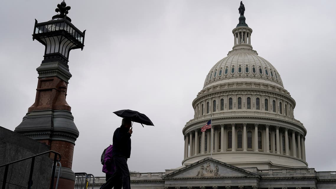 People walk past the Capitol Dome ahead of an expected vote in the impeachment trial of U.S. President Donald Trump on Capitol Hill in Washington, U.S., February 5, 2020. REUTERS/Joshua Roberts