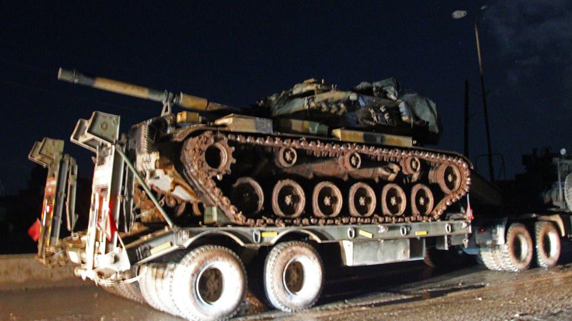 قافلة عسكرية تركية تتجه إلى إدلب يوم 7 فبراير (فرانس برس)