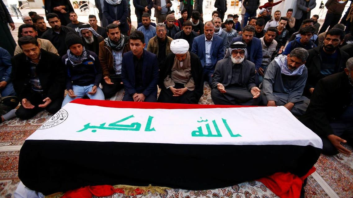 Mourners pray near a coffin of a demonstrator who was killed at an anti-government protest overnight in Nassiriya, during a funeral in Najaf. (Reuters)