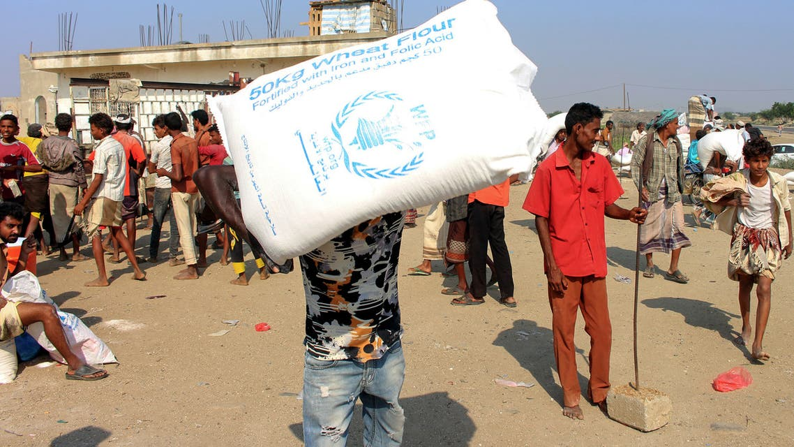 Displaced Yemenis receive humanitarian aid, donated by the World Food Programme (WFP) in cooperation with the Danish Refugee Counci ( DRC), in the northern province of Hajjah on December 30, 2019. Tens of thousands of people, most of them civilians, have been killed since Saudi Arabia and its allies intervened in March 2015 in support of the beleaguered government. The fighting has also displaced millions and left 24.1 million -- more than two-thirds of the population -- in need of aid.