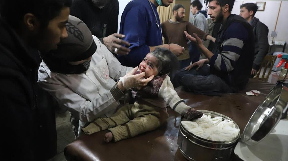 A Syrian infant receives treatment as victims of reported regime air strikes on Hamouria, Saqba and Kafr Batna are brought to a make-shift hospital in the rebel-held enclave of Eastern Ghouta on March 7, 2018. (AFP)