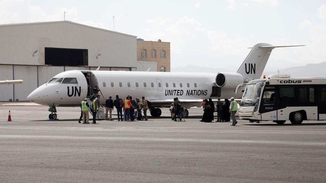 Yemenis board a United Nation plane at Sanaa International airport, Yemen, Monday, Feb. 3, 2020. (AP)