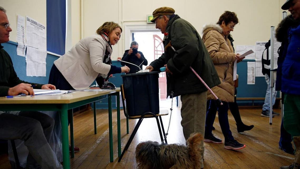 A man casts his vote in Ireland's national election in Cork, Ireland. (Reuters)