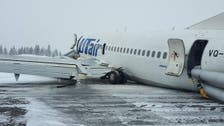 Russian plane carrying 100 people crash-lands on belly, no one hurt