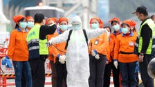 China health body urges against 'excessive, disorderly use' of protective suits