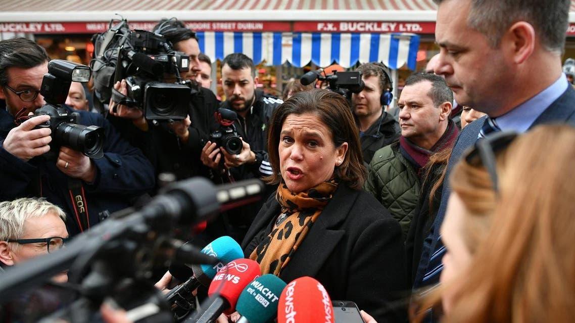 Sinn Fein President Mary Lou McDonald speaks to members of the media as she canvasses for support in Dublin on February 6, 2020. (AFP)