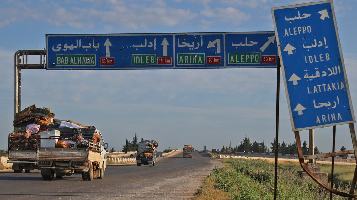 Syrians drive with their belongings along the main Damascus-Aleppo highway near the town of Saraqib in Syria's jihadist-held Idlib province on May 9, 2019 as they flee possible air strikes by the regime and its allies in the area. Violence in the northwestern Syrian region of Idlib has displaced more than 150,000 people in the past week, the UN said, as the regime and Russia upped deadly bombardment of the jihadist bastion. The uptick in strikes and shelling on the region dominated by Syria's former Al-Qaeda affiliate has also knocked 12 hospitals and 10 schools out of action, it said.