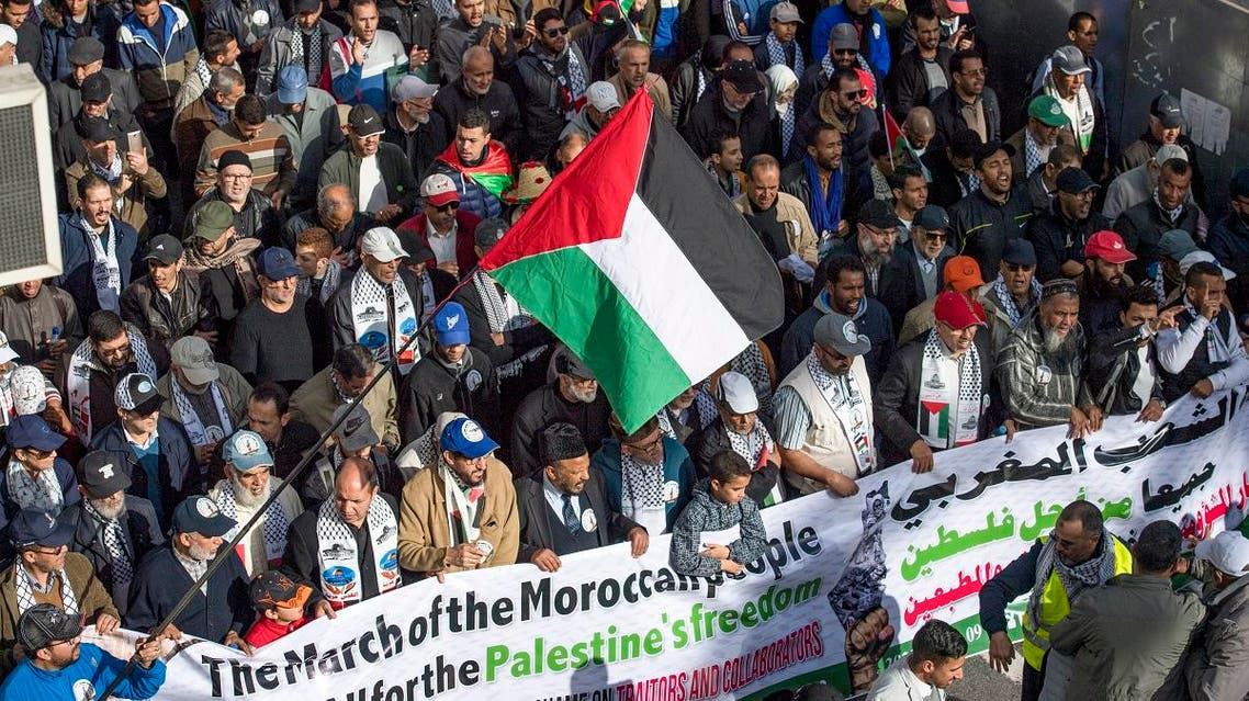 Moroccans wave the Palestinian flag during a demonstration against the US Middle East peace plan in the capital Rabat on February 9, 2020. (AFP)