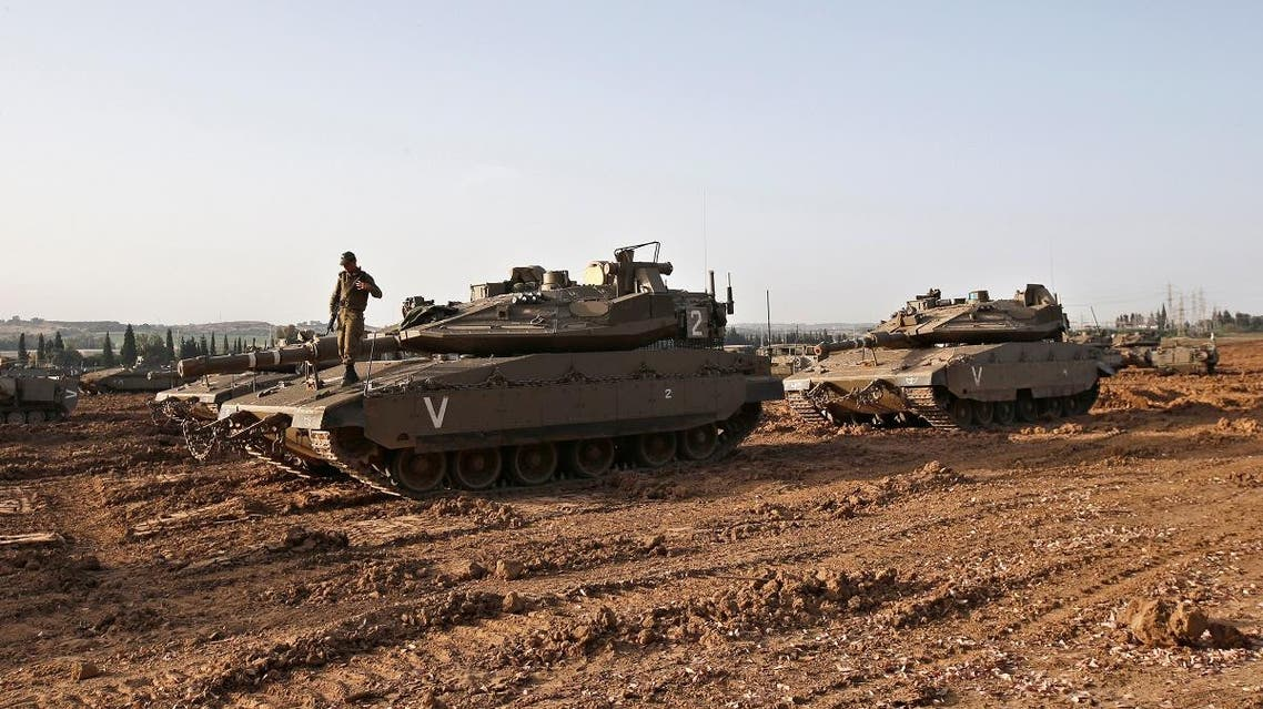An Israeli soldier stands atop of a tank near the border with Gaza, in southern Israel. (Reuters)