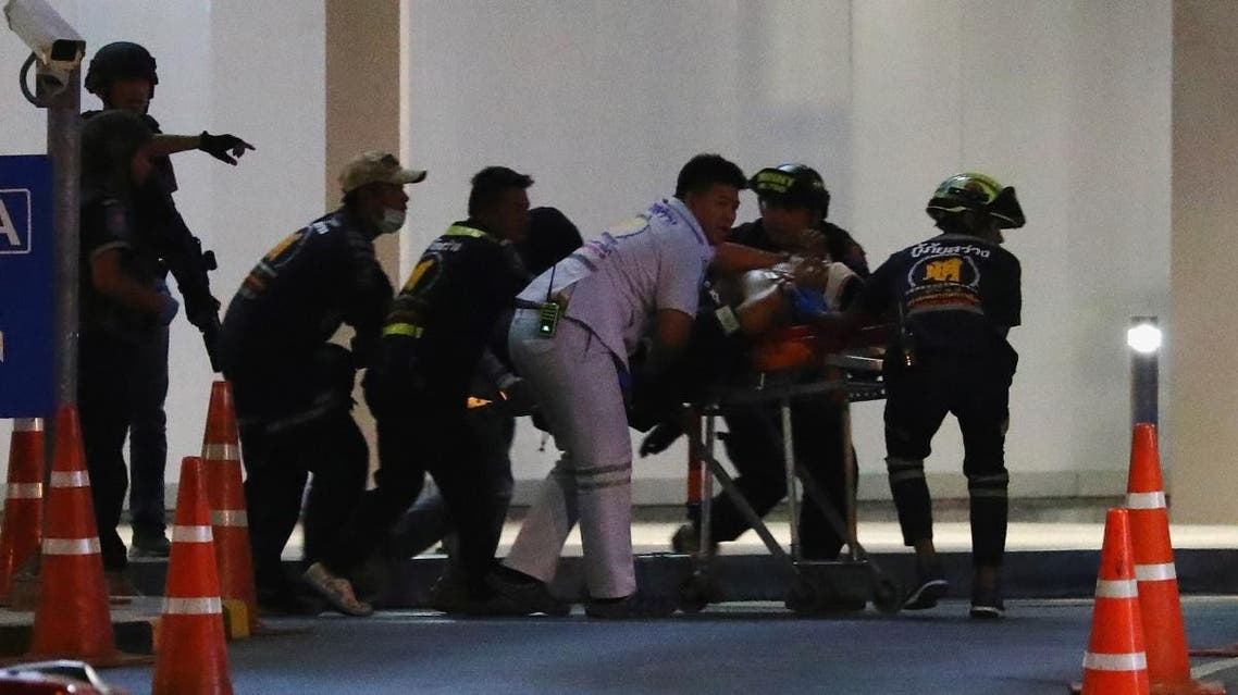 An injured member of Thai security forces is stretchered out after a raid inside the Terminal 21 shopping mall to try to stop a soldier on a rampage after a mass shooting, Nakhon Ratchasima, Thailand. (Reuters)
