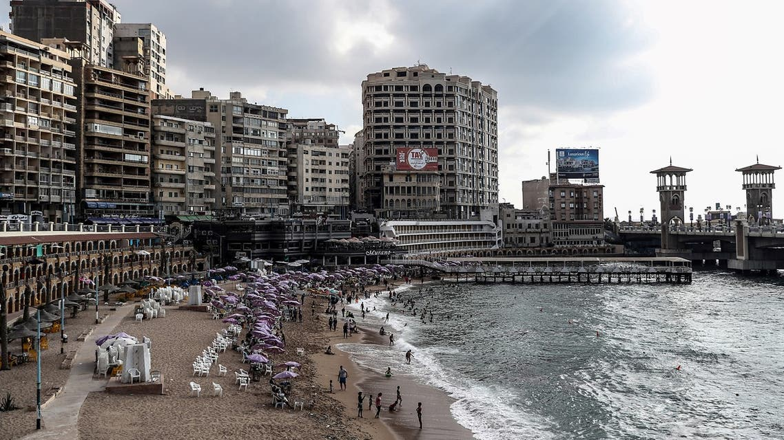 Egyptians bathe during summer vacations at a popular beach in the city of Alexandria, on August 01, 2019.
