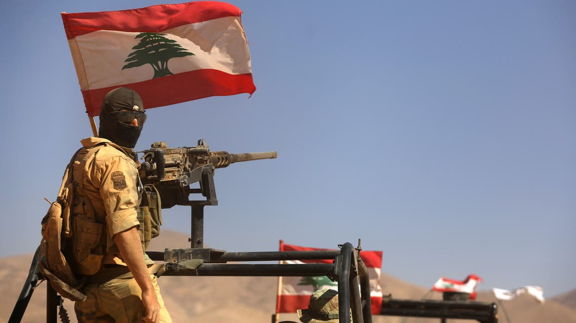 A picture taken on an army-organized press tour shows Lebanese army soldiers with the 6th Brigade driving vehicles flying the Lebanese flag in an area they recently took from the Islamic State (IS) group in Jurud Ras Baalbek on the Syrian-Lebanese border on August 28, 2017.