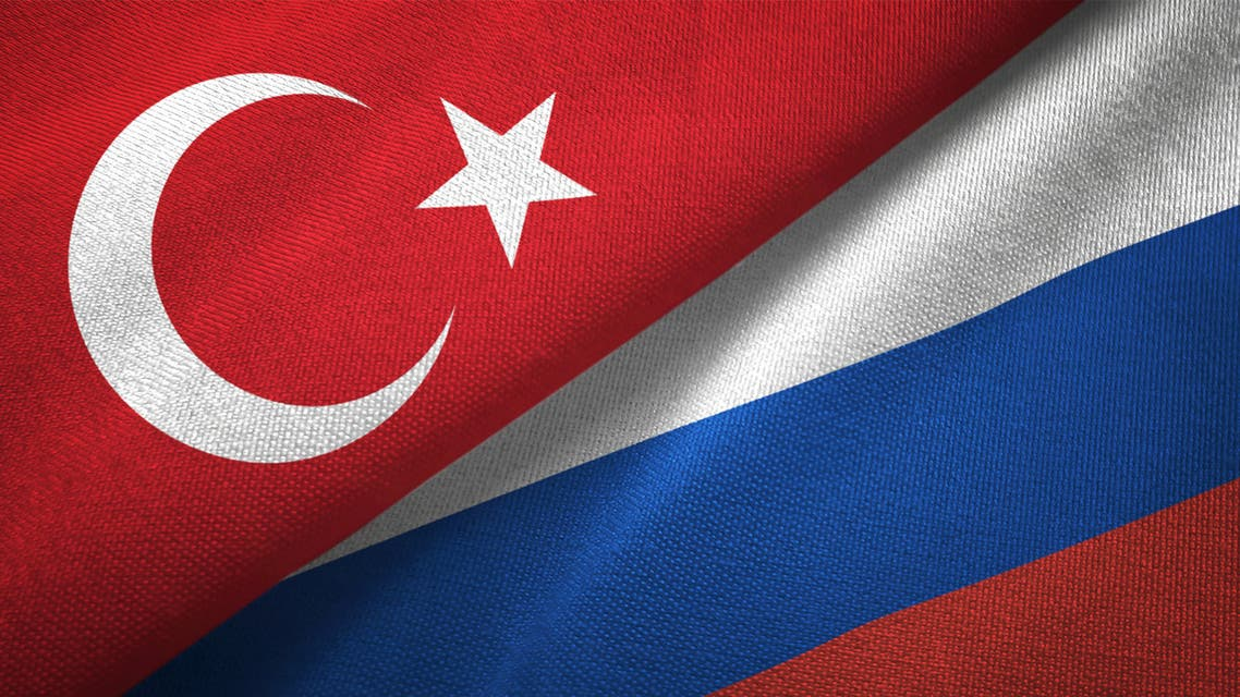 Russia and Turkey two flags together textile cloth fabric texture stock photo