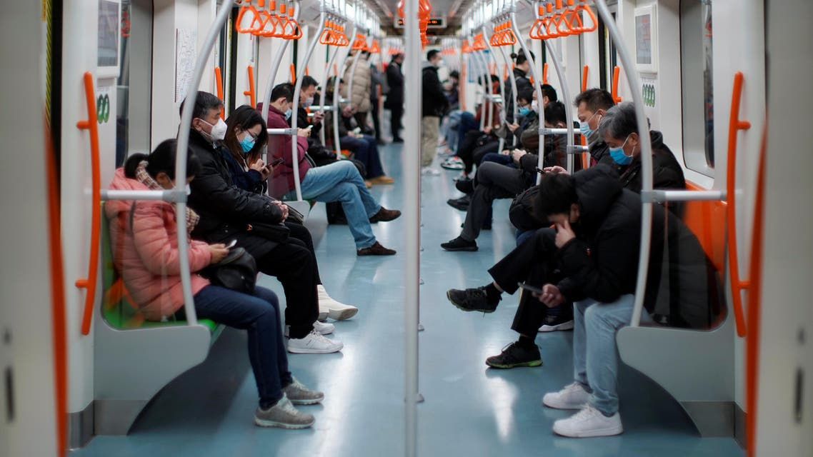 People wearing face masks ride a subway in the morning after the extended Lunar New Year holiday caused by the novel coronavirus outbreak, in Shanghai, China February 10, 2020. REUTERS