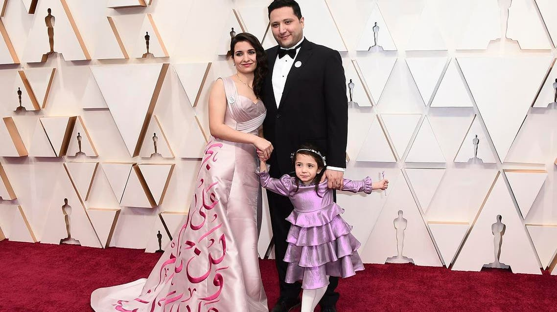 Waad Al-Kateab (left), and Hamza Al-Kateab arrive at the Oscars on February 9, 2020, at the Dolby Theatre in Los Angeles. (AP)