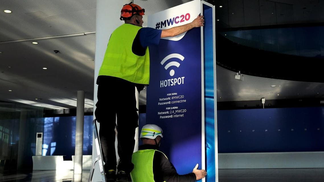 Employees place a banner with information of MWC20 (Mobile World Congress) in Barcelona, Spain, on February 5, 2020. (Reuters)
