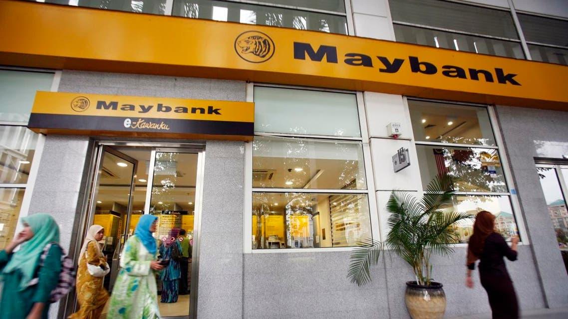 Customers leaving a branch of Malaysia's Maybank in Putrajaya. (Reuters)