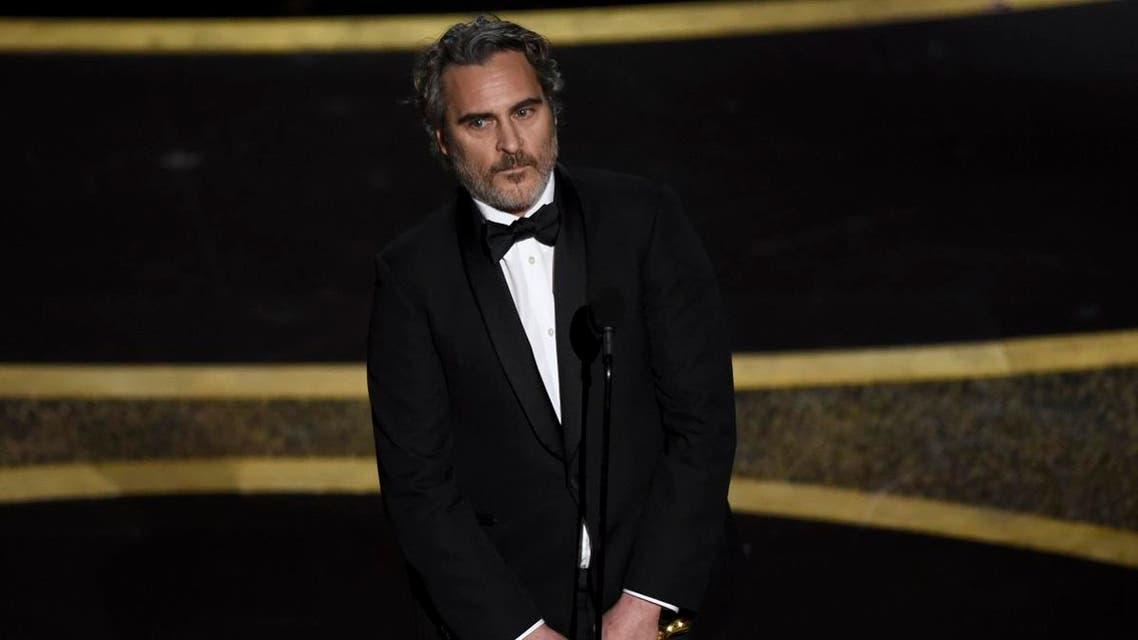 """Joaquin Phoenix accepts the award for best performance by an actor in a leading role for """"Joker"""" at the Oscars on Sunday, Feb. 9, 2020. (Photo: AP)"""