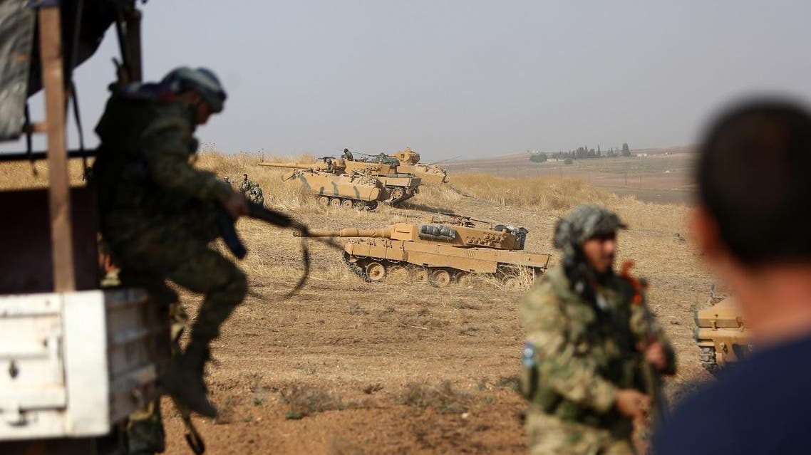Turkish soldiers gather with their tanks at a position east of the northeastern Syrian town of Ras al-Ain on October 28, 2019. (File photo: AFP)