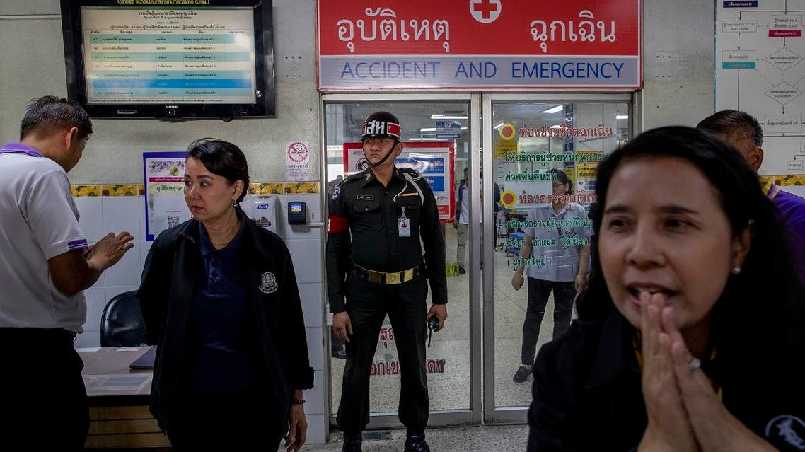 Military police stand outside an emergency room of a hospital where victims of the mass shooting are being treated in Korat, Nakhon Ratchasima, Thailand, on February 9, 2020. (AP)