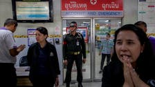Families of Thai shooting victims wait for answers, bodies of loved ones