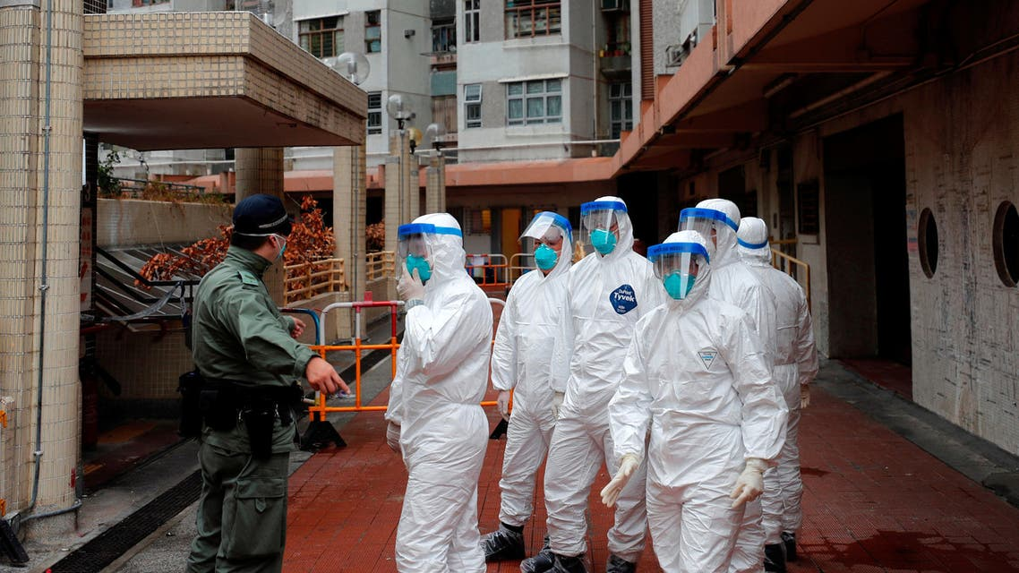 Police in protective gear wait to evacuate residents from a public housing building, following the outbreak of the novel coronavirus, in Hong Kong, China February 11, 2020. (Reuters)