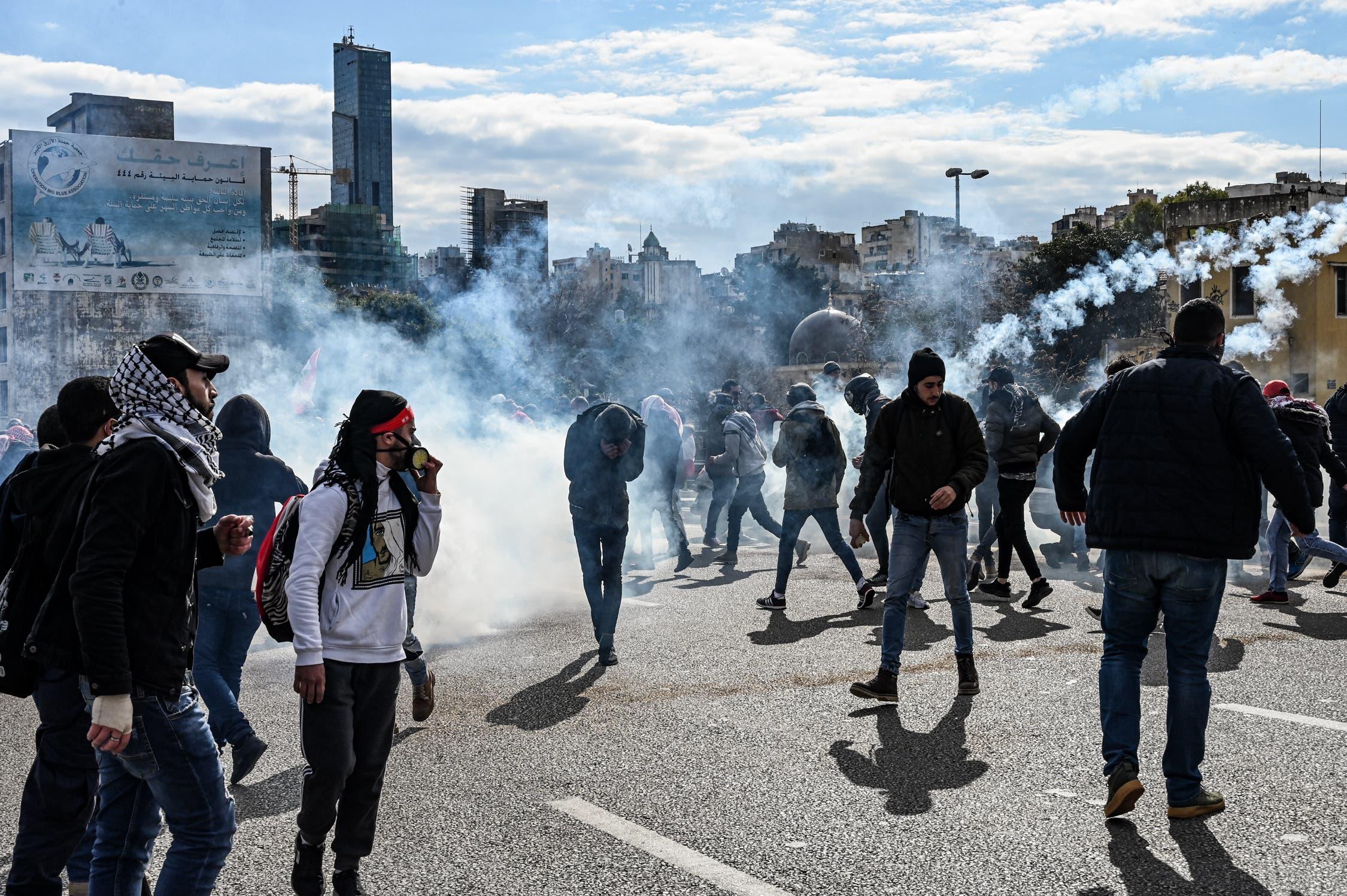 A protestor flees in incoming volley of tear gas. (Finbar Anderson)