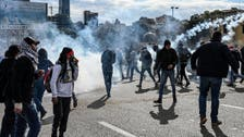 Lebanon government wins confidence vote as protesters, security forces clash