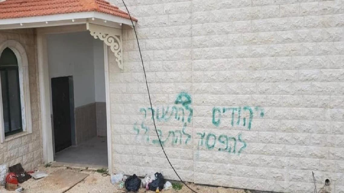A photo shows slogans sprayed on a mosque wall. (Twitter)