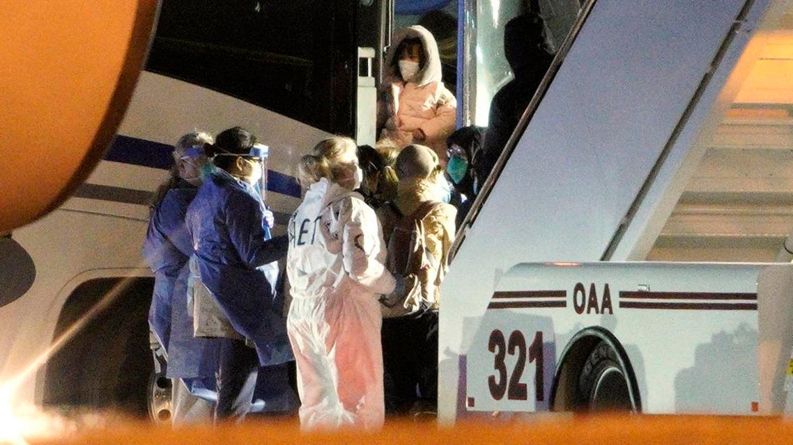 American evacuees from the coronavirus outbreak in China board a bus after arriving by flight to Eppley Airfield in Omaha, Neb., Friday, Feb. 7, 2020. (Photo: AP)
