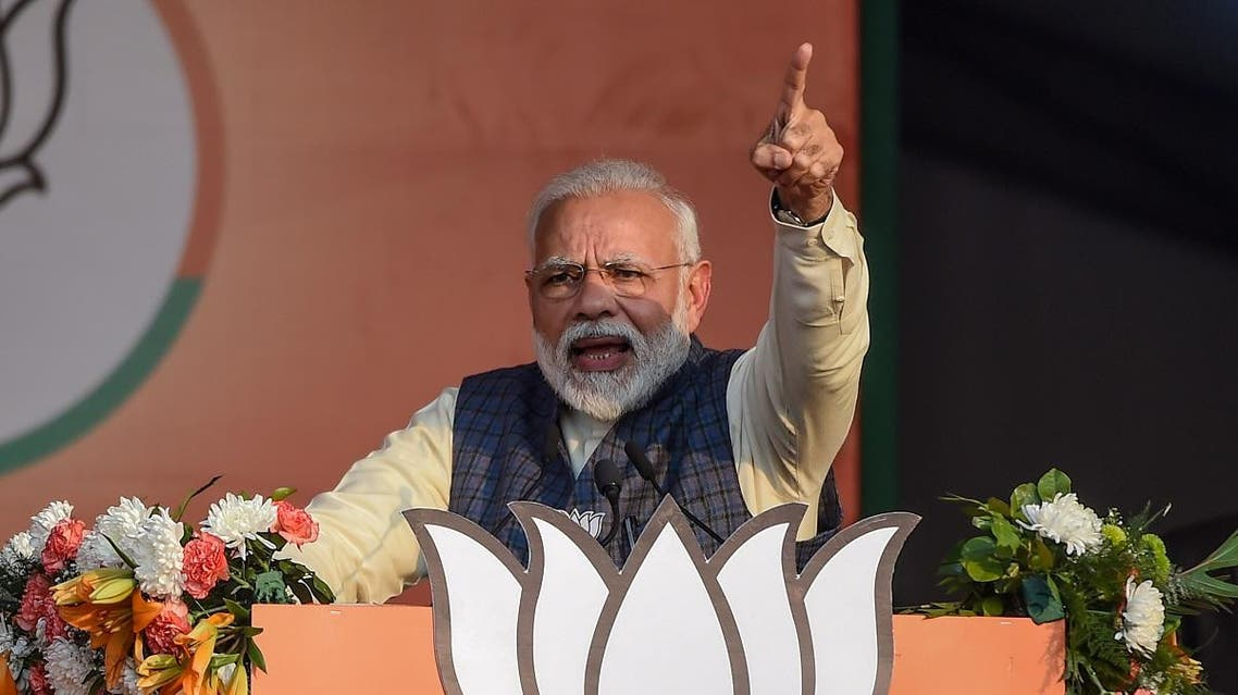 India's Prime Minister and Bharatiya Janata Party (BJP) leader Narendra Modi gestures as he speaks during a rally for the upcoming Delhi state elections in New Delhi. (AFP)