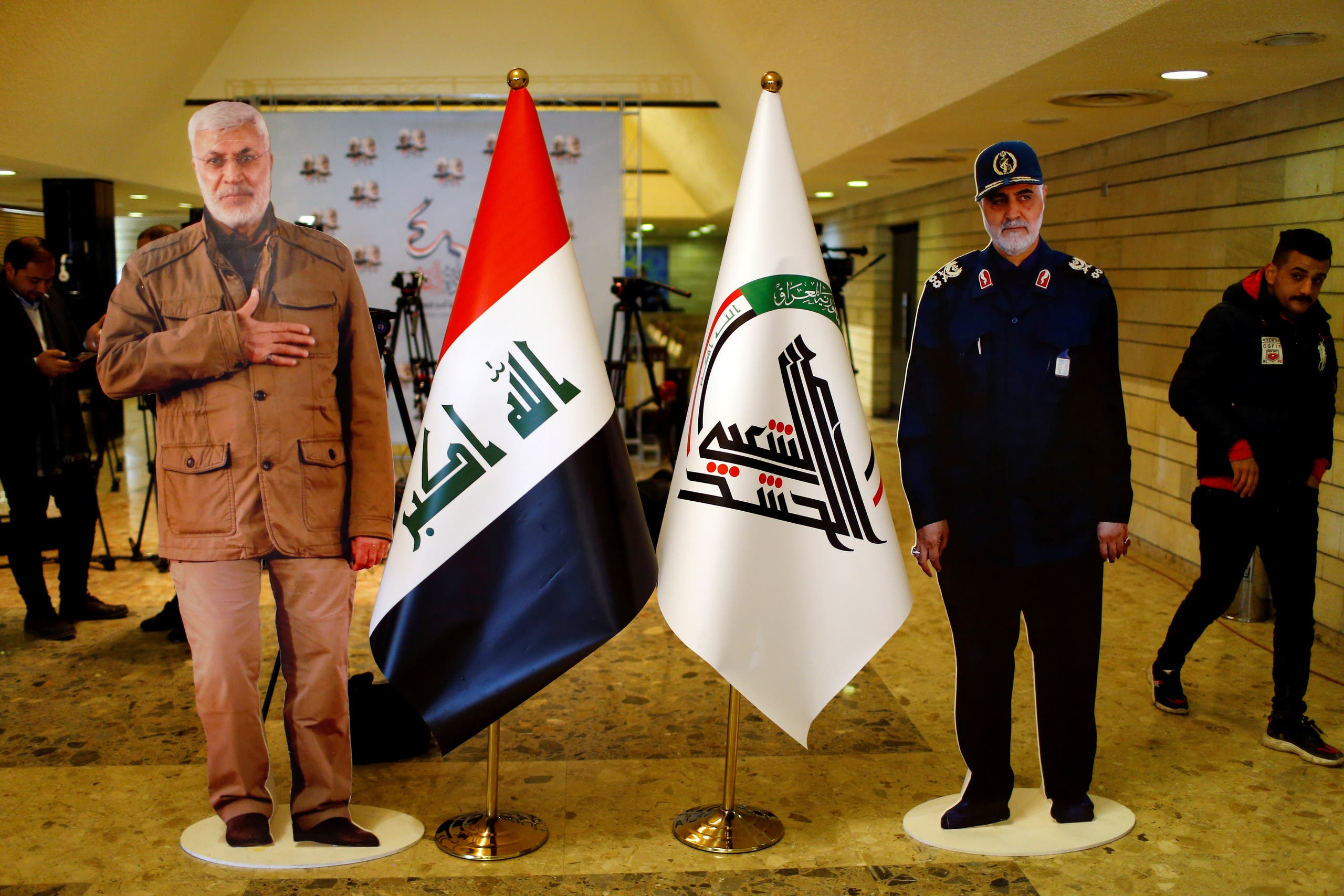 Cardboard cutouts of the Qassem Soleimani and Abu Mahdi al-Mohandes are seen during the forty days memorial in Baghdad, Iraq, February 11, 2020. (Reuters)