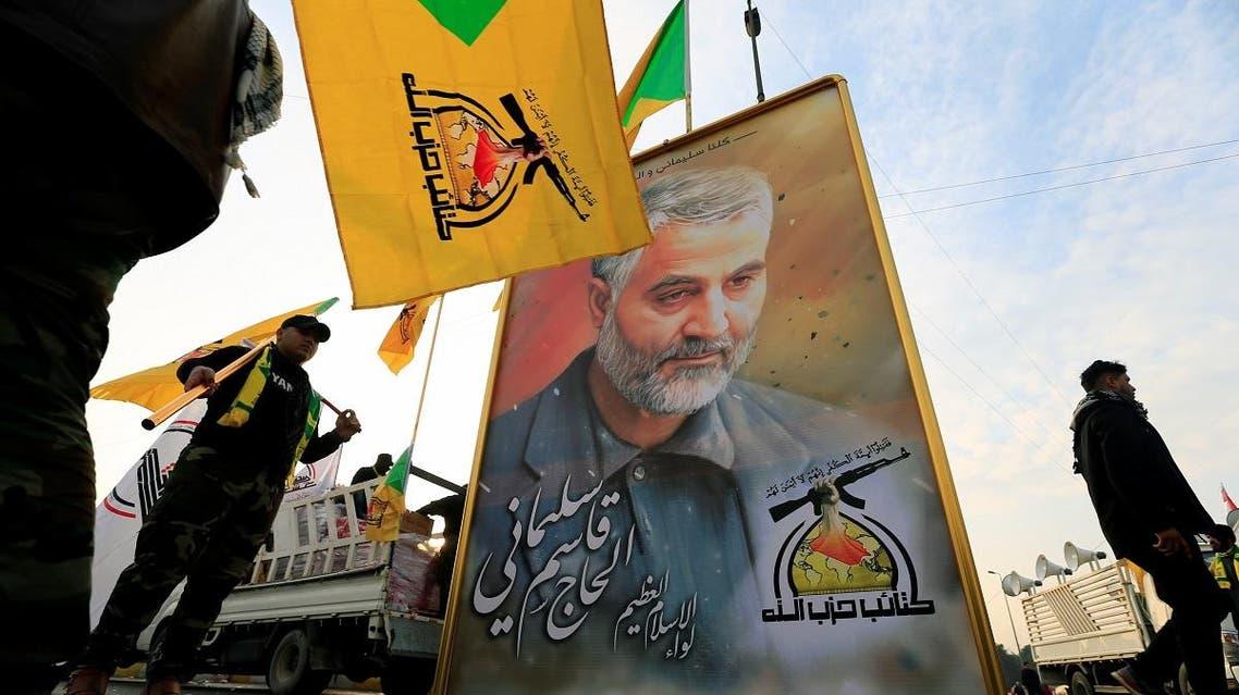 Kataib Hezbollah Iraqi militia hold the picture of the Iranian Major-General Qassem Soleimani, as they gather ahead of the funeral of the Iraqi militia commander Abu Mahdi al-Mohandes, in Baghdad. (Reuters)