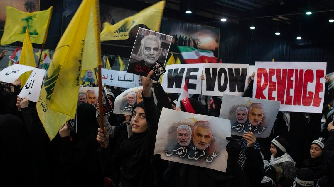 """Supporters of Hezbollah leader Sayyed Hassan Nasrallah wave flags and placards that say """"we vow revenge,"""" ahead of the leader's televised speech in a southern suburb of Beirut. (AP)"""
