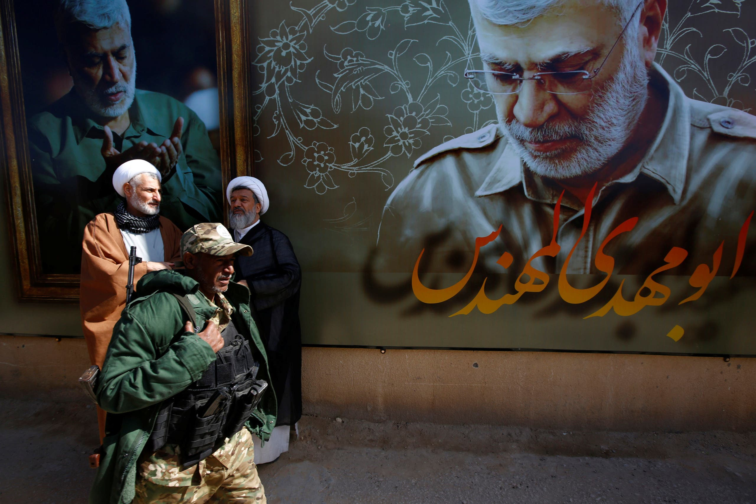 من موقع اغتيال سليماني وابو مهدي المهندس في بغداد(فرانس برس)