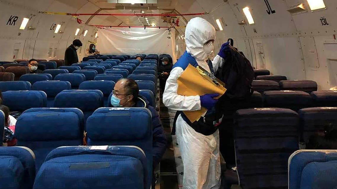 Staff from the US embassy walk in a cargo plane, during the boarding process at Wuhan Tianhe International Airport in Wuhan on February 7, 2020. (AP)