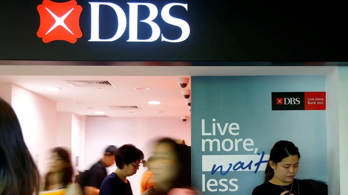 People walk past a DBS branch in Singapore October 8, 2019. (File photo: Reuters)