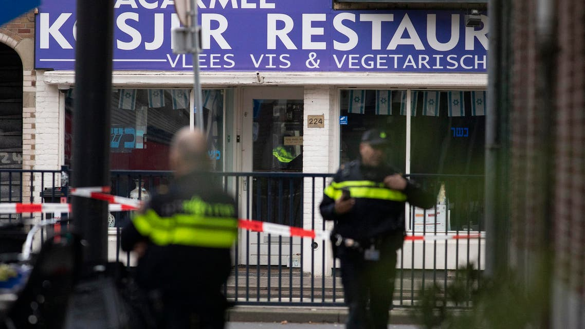 A suspect package, center bottom, is seen on the doorstep of Kosher restaurant HaCarmel as police enlarges the secured perimeter in Amsterdam, Netherlands, in January. (AP)