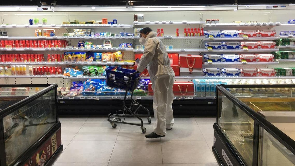 Customer pushes a cart while shopping inside a supermarket of Alibaba's Hema Fresh chain, following an outbreak of the novel coronavirus in Wuhan. (Reuters)