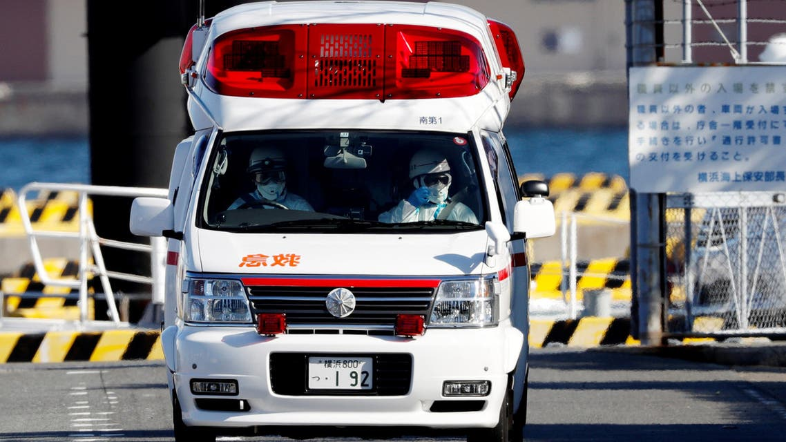 Ambulance workers in protective gear drive an ambulance near cruise ship Diamond Princess, at a maritime police's base in Yokohama, south of Tokyo, Japan February 5, 2020. (Reuters)