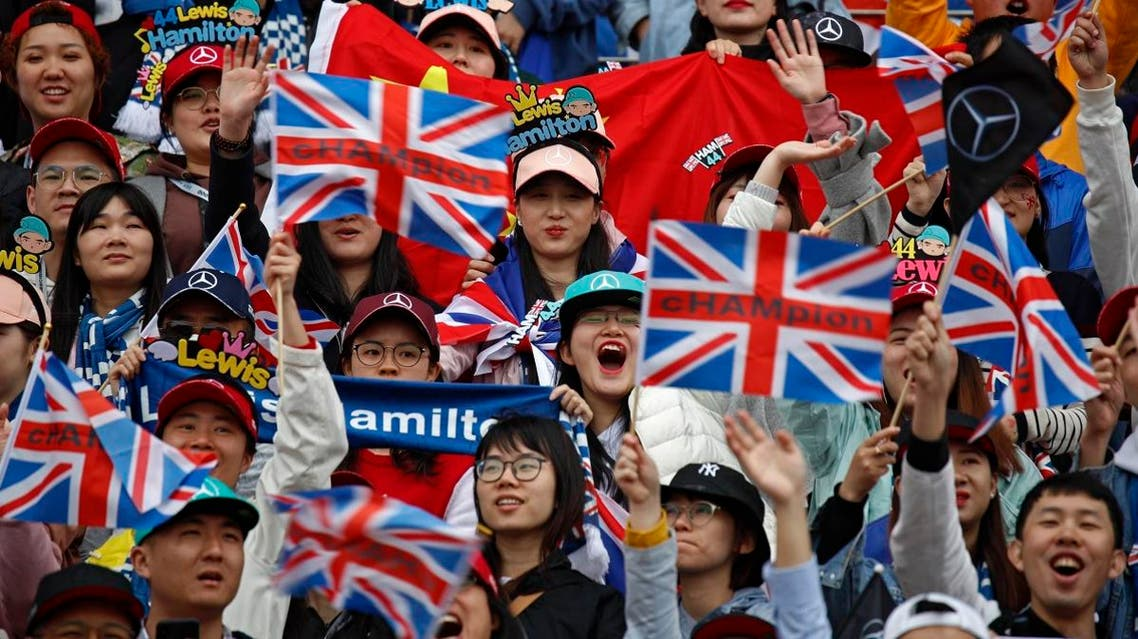 Fans of Mercedes driver Lewis Hamilton of Britain cheer after Hamilton wins the Chinese Formula One Grand Prix at the Shanghai International Circuit in Shanghai, Sunday, April 14, 2019. (AP)