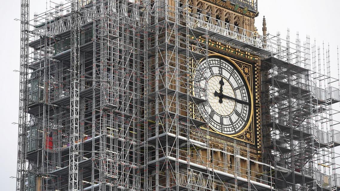 The Elizabeth Tower, housing the Big Ben bell, is seen clad in scalffolding, over the Houses of Parliament, in central London. (Reuters)