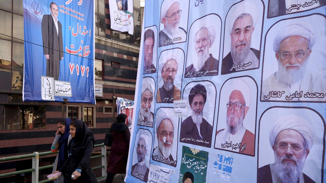 Women walk past electoral posters for the upcoming elections in central Tehran February 24, 2016. (Reuters)